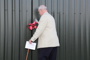 Sir John cutting the ribbon