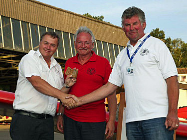 Bob receives Gliding Heritage Centre medal No. 1 from Colin Simpson and Gary Pullen