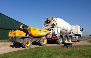 Receiving Concrete to Pour in the Dumper